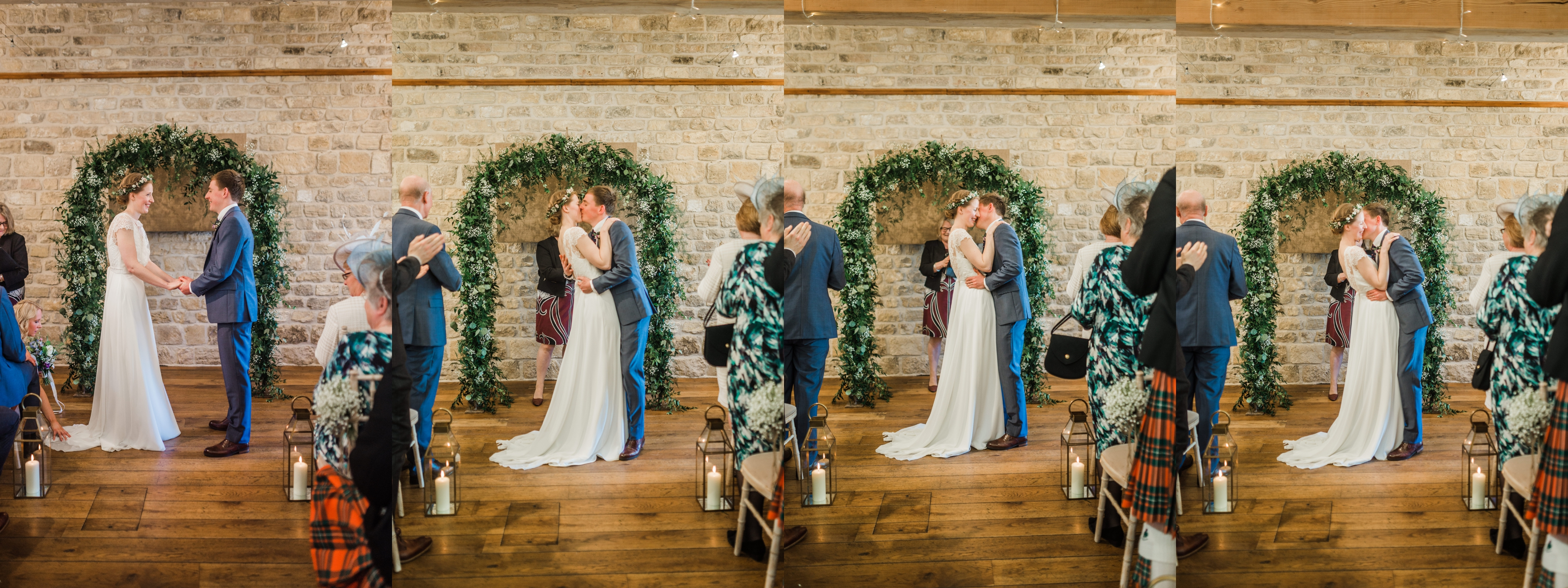 Bride and Groom share first kiss at a leafy alter