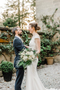 Bride and groom gaze to each other at Middleton Lodge